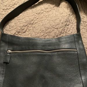 The Sak purse. Black leather.